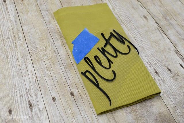 vinyl cutout on green napkin