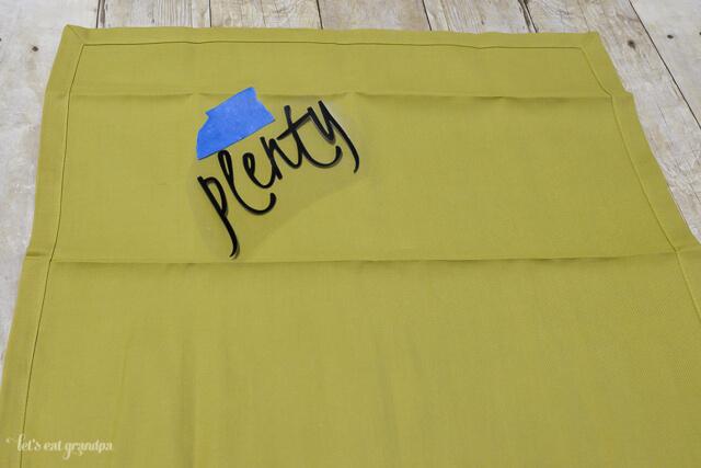 vinyl word taped to green napkin