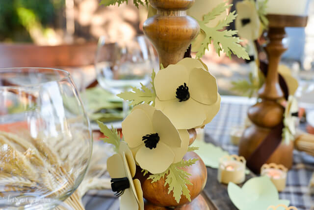 paper flowers on candle pillar for table decor
