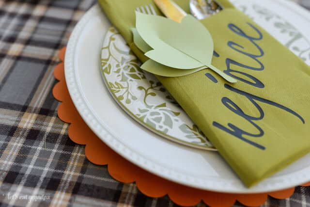paper leaf on Thanksgiving napkin place setting
