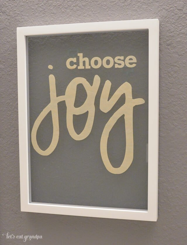 Choose joy floating artwork on wall