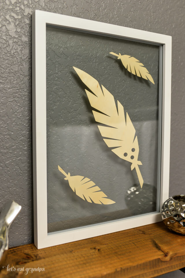 feather floating artwork in bathroom
