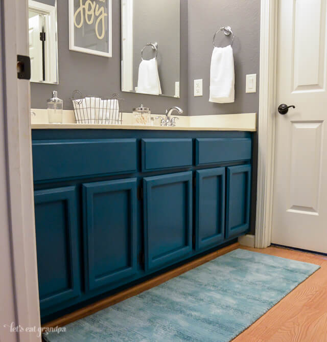 side view of finished 1980s bathroom makeover with teal cabinets