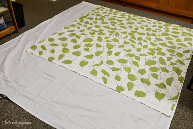 custom shower curtain using a flat sheet and old shower curtain as a template