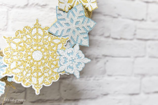 Have a Cricut Explore? Make this cute and simple burlap and snowflake wreath! It's a super quick project -- your holidays, made easier!