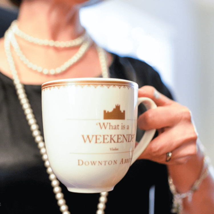 Woman holding Downton Abbey mug