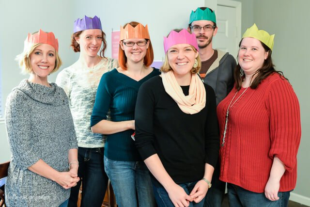 group of friends with paper crowns on