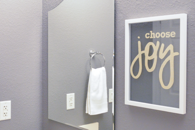 Choose joy floating artwork in bathroom