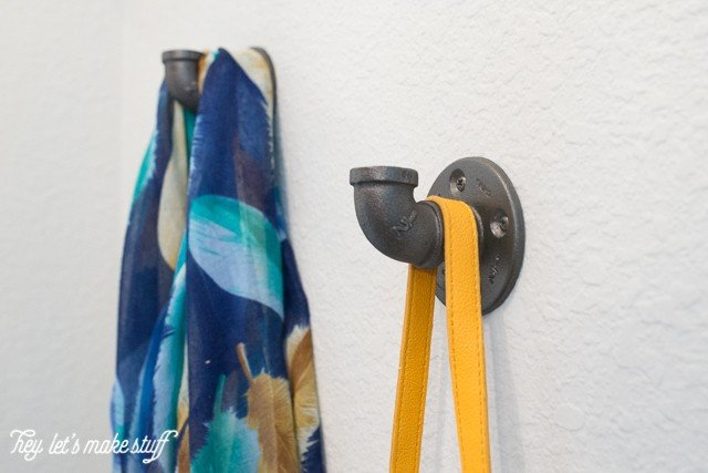industrial hooks for purse and scarf in entryway