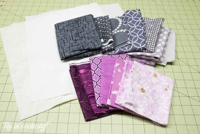 purple and gray fabric pieces on sewing mat