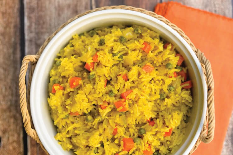 Sabzi pilau, which is an Indian spiced rice, is a delicious accompaniment to any Indian dish. Bright turmeric, rich spices, and healthy veggies help spice up this yummy side dish.