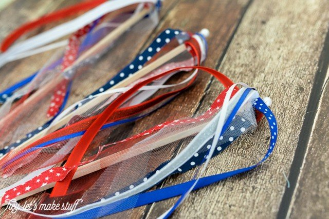 finished red, white and blue DIY patriotic streamers on wood