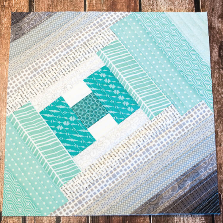 Quilt as you go finished quilt block with teals and grays