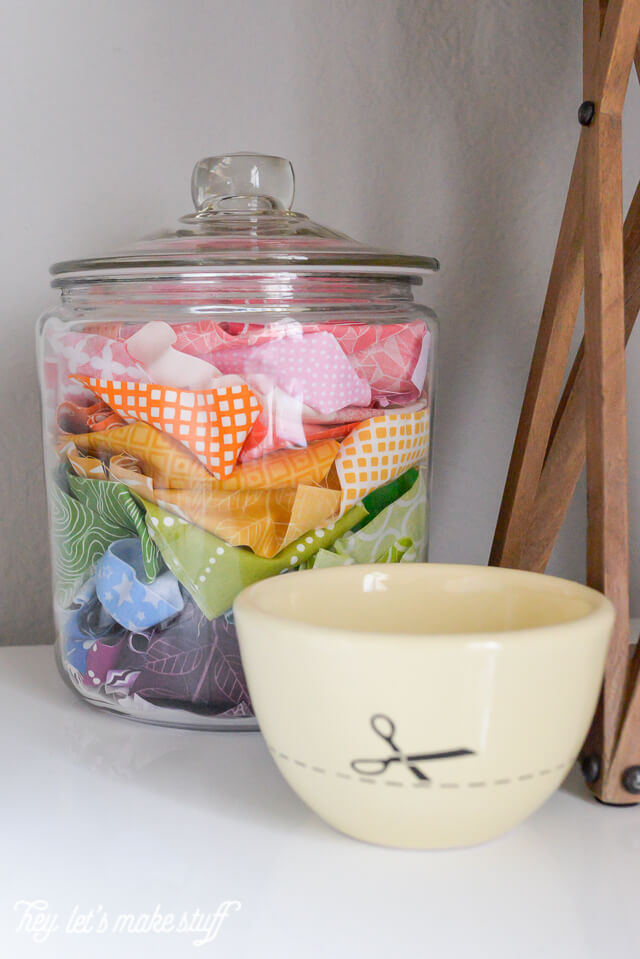 clear glass jar holding colorful fabric scraps
