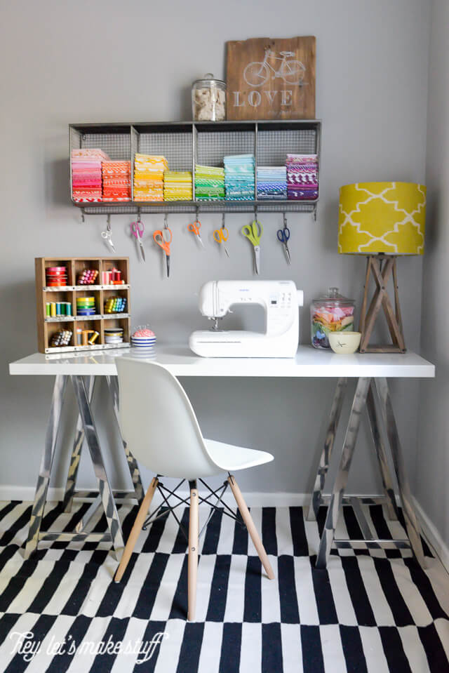 sewing table in colorful craft room