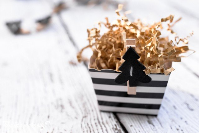 black and white striped box with crinkle paper for candy advent calendar