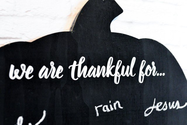 Make a gratitude chalkboard! Have everyone write what they're thankful for on this cute pumpkin chalkboard, and then snap a photo. Do it every year to have a record of what you're grateful for as the years go by!