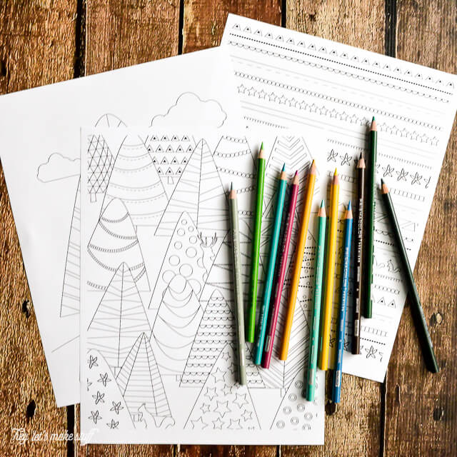 printable coloring wrapping paper with colored pencils on wooden background