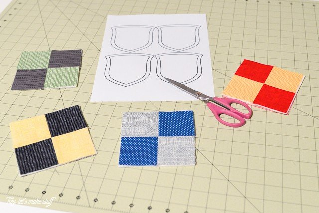 sewing pattern and fabric squares for  Harry Potter house crest ornaments