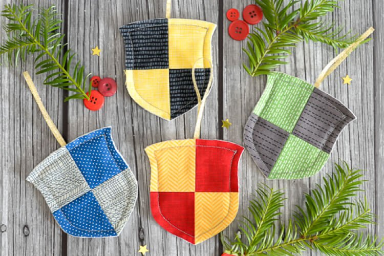 simple raw-edge Hogwarts house crest ornaments for Gryffindor, Hufflepuff, Ravenclaw, and Slytherin