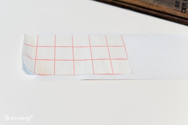 transfer tape on Cricut vinyl to make lost sock holder