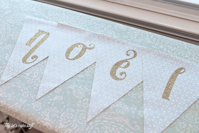 Using a few simple sewing skills and your Cricut Explore, make this beautiful set of pennants to celebrate the Christmas Season.