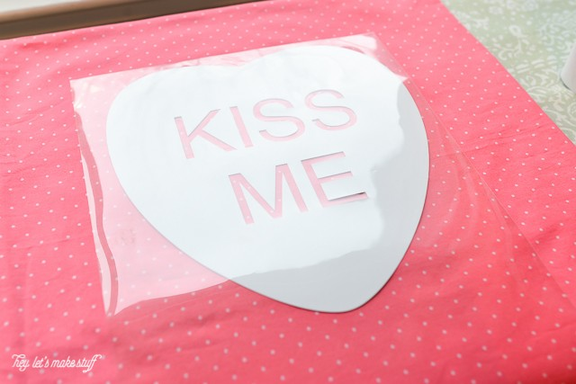 Cricut Iron-On Vinyl is one of my favorite things! Here are step by step instructions on how to use it to make these adorable conversation heart pillow cases! Includes free cut files, too!