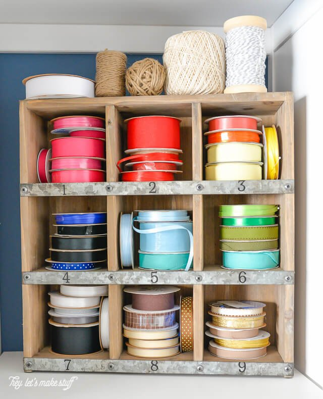 colored ribbon spools organized in craft room
