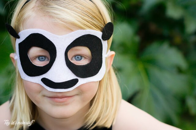 young girl wearing DIY Kung Fu panda mask