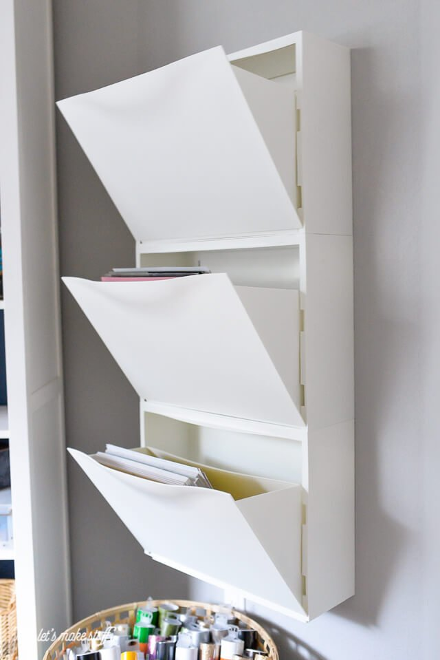 IKEA Hack: Trones Shoe Holders stacked on wall and opened to hold scrapbook paper