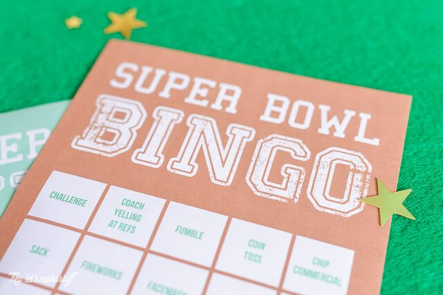 close up of Super Bowl Bingo printable cards on fake grass background