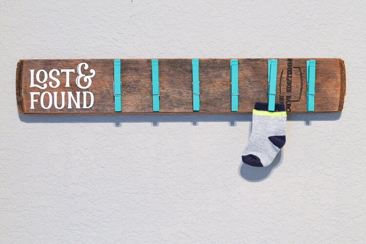 DIY lost sock wooden holder with clothespins and one sock