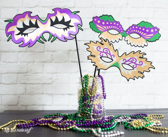 These masks are perfect for a Mardi Gras party -- either as part of a costume or as photo booth props. They even work as decorations because you can cut them any size you'd like on your Cricut.