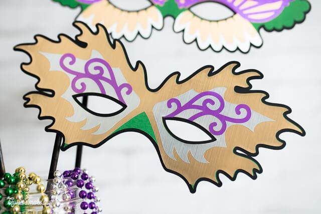 paper cut out Mardi Gras mask