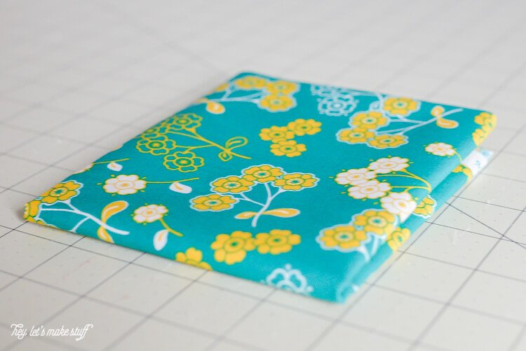 Learn the quick and easy way to fold fat quarters and half yards for easy storing in your sewing space!