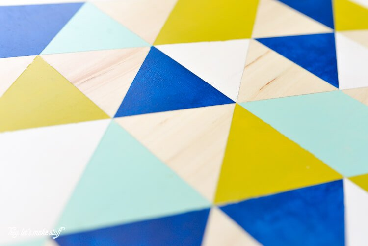 """Take a simple IKEA """"SNUDDA"""" Lazy Susan and dress it up with @frogtape and paint! A fun, geometric DIY."""