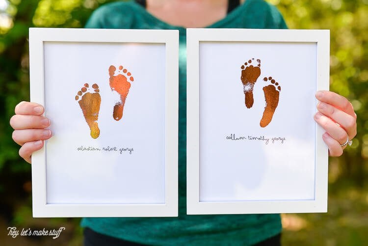 two sets of foiled footprint art from newborn's footprints