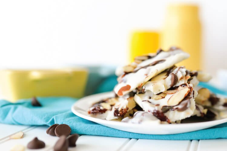This frozen yogurt bark is a fun treat on a hot day! This recipe uses chocolate chips, dried cherries, and slivered almonds, but you can use any mix-ins that you love.