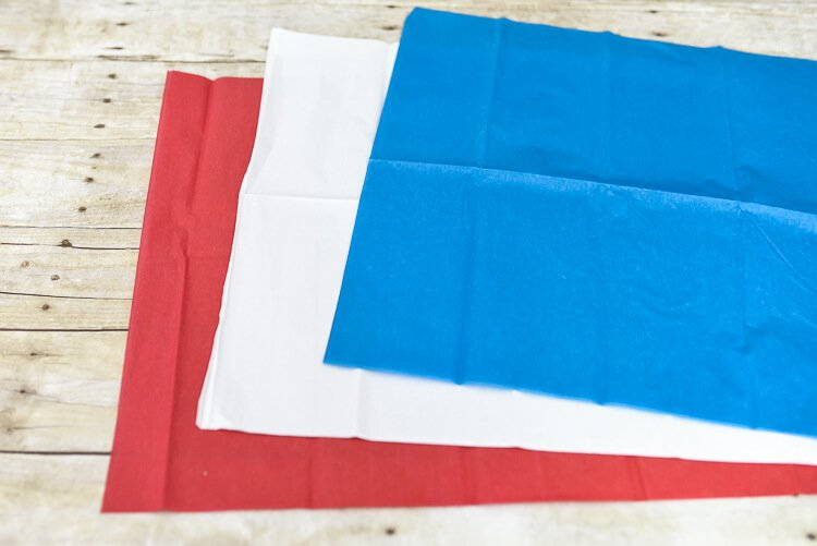 Red, white, and blue tissue paper to make fireworks
