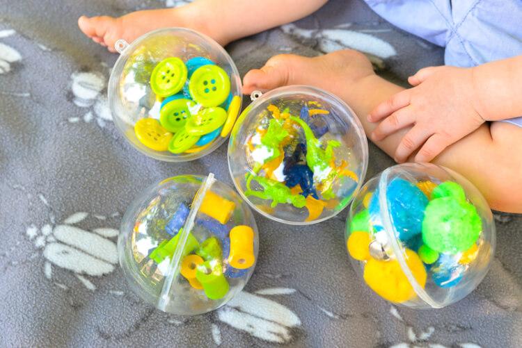 fun toddler sound shaker toys using plastic ornaments and Gorilla Glue!