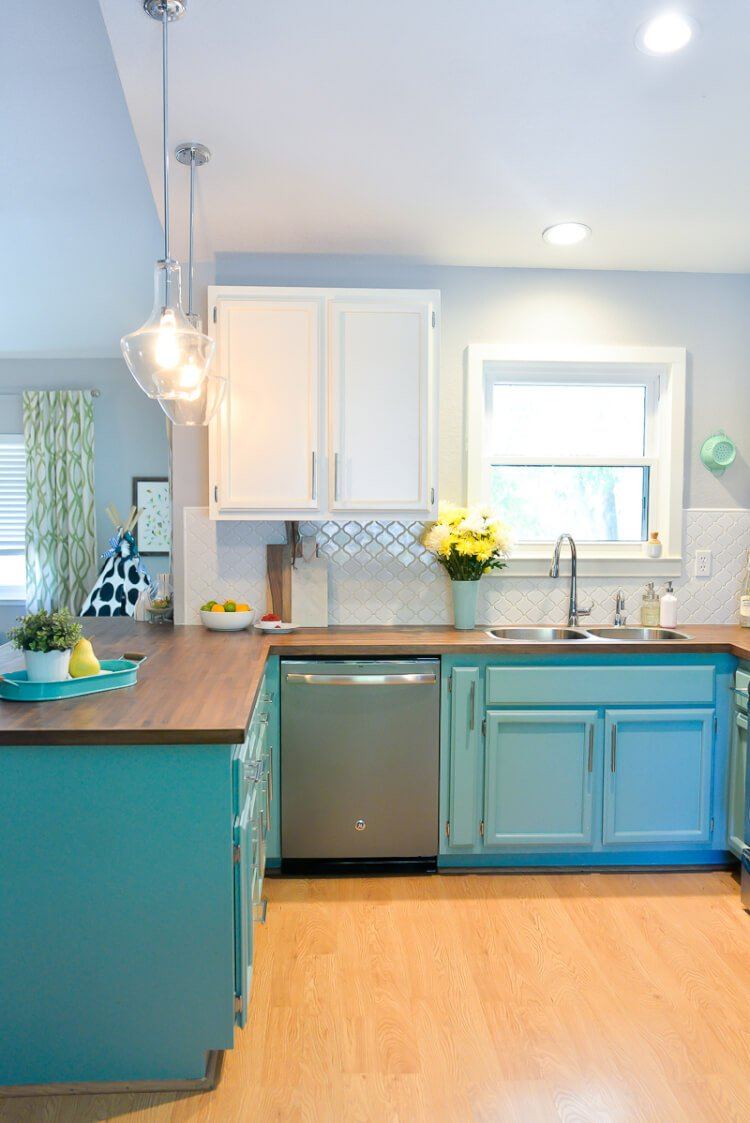 modern farmhouse budget kitchen renovation affordable kitchen countertops We totally transformed our dated s kitchen with bright painted cabinets new lighting and