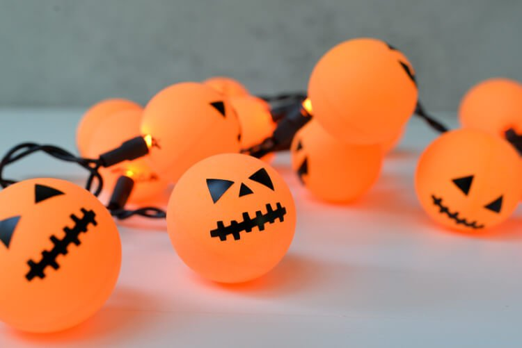orange ping pong balls plus fairy lights equal a fun halloween jack o lantern decoration - Halloween Ping Pong Balls