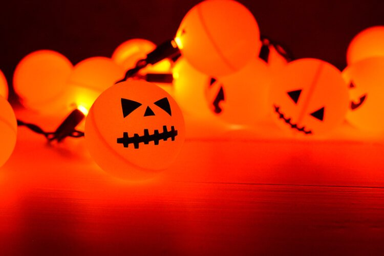 Orange ping pong balls plus fairy lights equal a fun DIY Halloween Jack O' Lantern decoration!