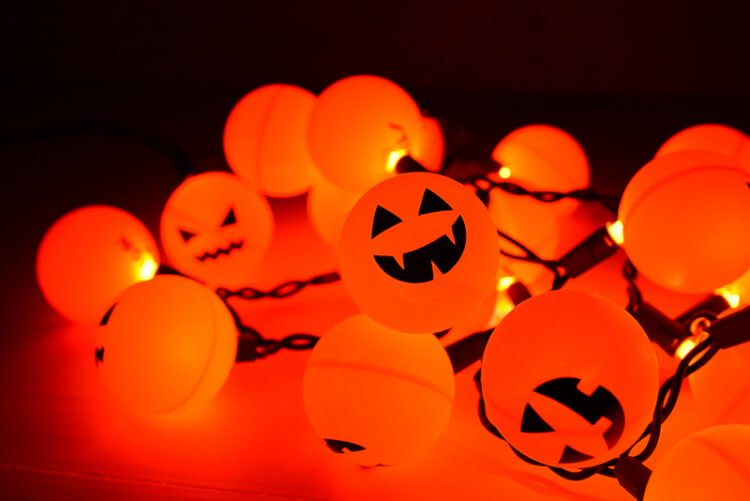 Orange ping pong balls plus fairy lights equal a fun Halloween Jack O' Lantern decoration!