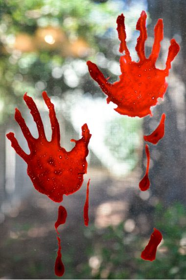 With just craft glue and food coloring, you can easily create this totally creepy Halloween decoration -- bloody handprint window clings! Great on doors, windows, and mirrors.