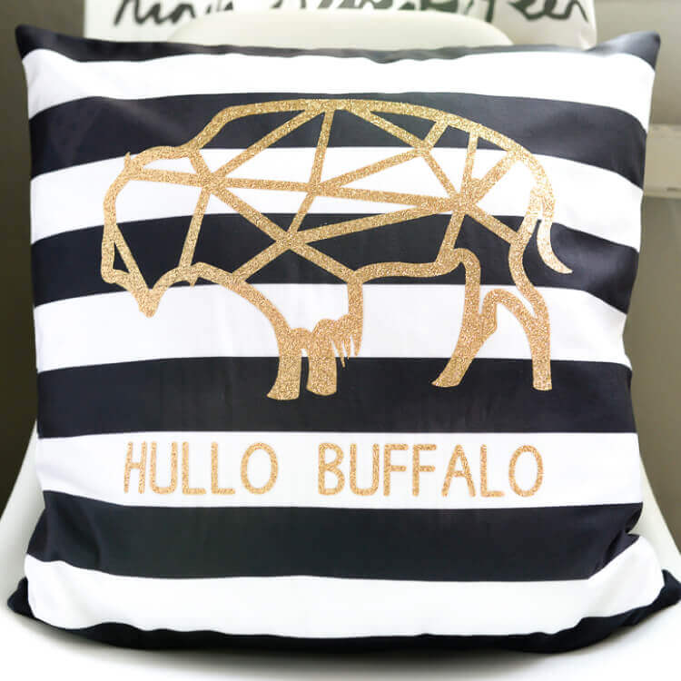 Use your Cricut Explore Air 2 to make this modern buffalo pillow using glitter iron-on vinyl