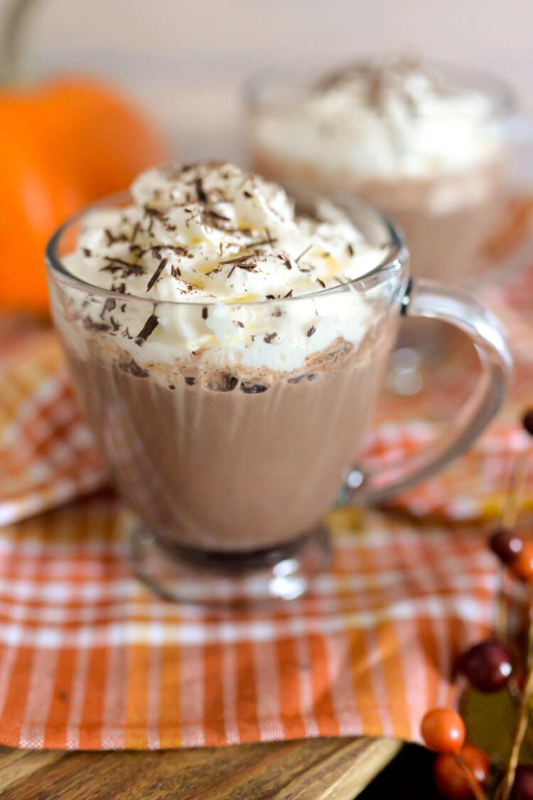 This boozy combo of dark hot chocolate, smooth bourbon, and sweet cointreau is perfect to drink fireside during cool fall nights!