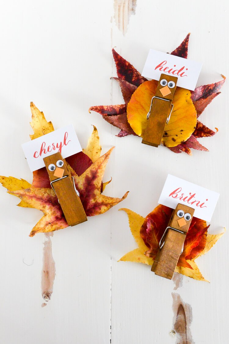 These easy turkey place card holders are super simple to make -- gather fall leaves and attach them to a clothespin with eyes and beak to make a Thanksgiving place card everyone will love.