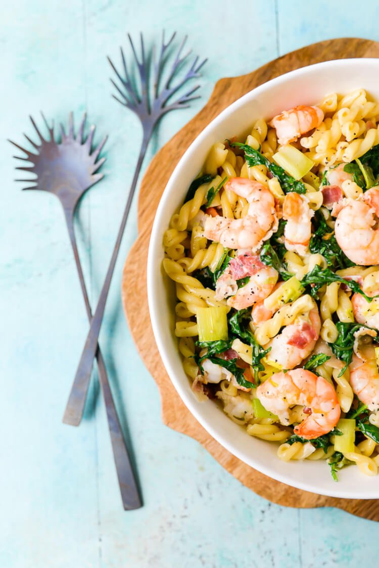 This creamy shrimp and kale pasta is a delicious weeknight dinner that come together in about thirty minutes. Plus it's extra savory with the addition of bacon and leeks in a simple creamy sauce.
