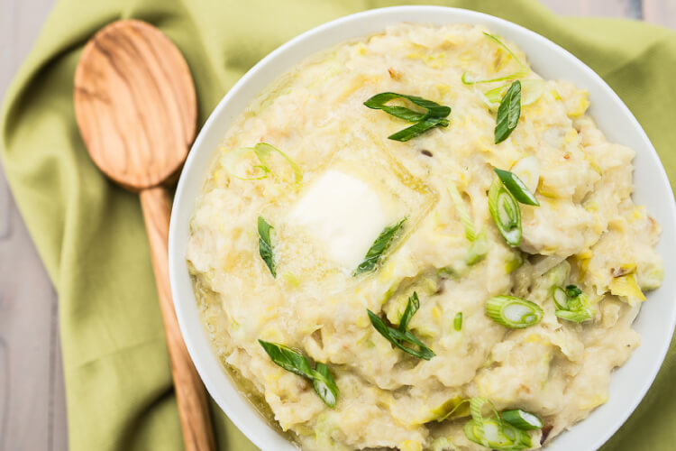 Colcannon is an Irish staple and is the perfect St. Patrick's Day side dish. Creamy buttery mashed potatoes plus leeks, garlic, and cabbage—you can't go wrong with this savory Irish dish!